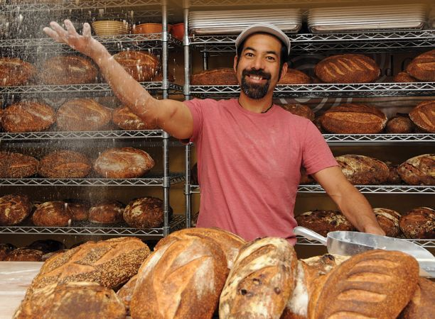 Don Guerra with loaves of bread